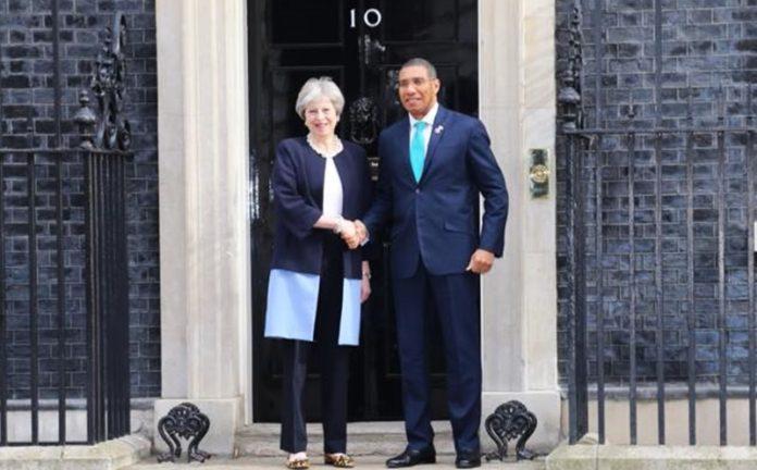 Teresa May greets Prime Minister Holness at 10 Downig Street